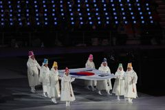 The 2018 Winter Olympics Opening Ceremony. PYEONGCHANG, SOUTH KOREA - FEBRUARY 9, 2018: Former South Korean Olympians and Olympic gold medalists carry the Royalty Free Stock Photography