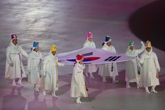 The 2018 Winter Olympics Opening Ceremony. PYEONGCHANG, SOUTH KOREA - FEBRUARY 9, 2018: Former South Korean Olympians and Olympic gold medalists carry the Stock Image
