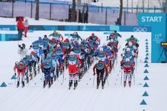 Mass start in the  Men`s 15km + 15km Skiathlon at the 2018 Winter Olympics Royalty Free Stock Image