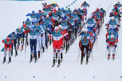 Mass start in the  Men`s 15km + 15km Skiathlon at the 2018 Winter Olympics. PYEONGCHANG, SOUTH KOREA - FEBRUARY 11, 2018: Mass start in the  Men`s 15km + 15km Stock Photo