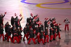 Olympic champion Anna Veith carrying the flag of Austria leading the Austrian Olympic team at the PyeongChang 2018 Winter Olympics. PYEONGCHANG, SOUTH KOREA stock images