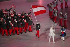 Olympic champion Anna Veith carrying the flag of Austria leading the Austrian Olympic team at the PyeongChang 2018 Winter Olympics. PYEONGCHANG, SOUTH KOREA royalty free stock photos