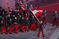 Olympic champion Anna Veith carrying the flag of Austria leading the Austrian Olympic team at the PyeongChang 2018 Winter Olympics. PYEONGCHANG, SOUTH KOREA stock image