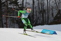 Olympic champion Darya Domracheva of Belarus competes in biathlon Women`s 15km Individual at the 2018 Winter Olympics. PYEONGCHANG, SOUTH KOREA - FEBRUARY 15 Royalty Free Stock Image