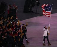 Olympic champion Erin Hamlin carrying the United States flag leading the team USA the PyeongChang 2018 Olympics opening ceremony. PYEONGCHANG, SOUTH KOREA Royalty Free Stock Photo