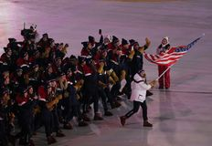 Olympic champion Erin Hamlin carrying the United States flag leading the team USA the PyeongChang 2018 Olympics opening ceremony. PYEONGCHANG, SOUTH KOREA Royalty Free Stock Image