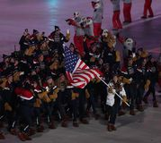 Olympic champion Erin Hamlin carrying the United States flag leading the team USA the PyeongChang 2018 Olympics opening ceremony. PYEONGCHANG, SOUTH KOREA Stock Images