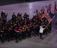 Olympic champion Erin Hamlin carrying the United States flag leading the team USA the PyeongChang 2018 Olympics opening ceremony. PYEONGCHANG, SOUTH KOREA Stock Photos