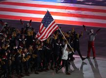 Olympic champion Erin Hamlin carrying the United States flag leading the team USA the PyeongChang 2018 Olympics opening ceremony. PYEONGCHANG, SOUTH KOREA Royalty Free Stock Images
