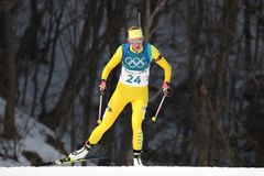 Olympic champion  Hanna Oeberg of Sweden competes in biathlon Women`s 15km Individual at the 2018 Winter Olympics. PYEONGCHANG, SOUTH KOREA - FEBRUARY 15, 2018 Stock Images