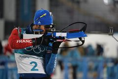 Olympic champion Martin Fourcade of France competes in the biathlon men`s 15km mass start at the 2018 Winter Olympics. PYEONGCHANG, SOUTH KOREA  FEBRUARY 18 Royalty Free Stock Photos