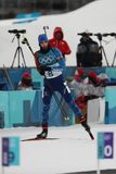 Olympic champion Martin Fourcade of France competes in biathlon men`s 12.5km pursuit at the 2018 Winter Olympics. PYEONGCHANG, SOUTH KOREA - FEBRUARY 12, 2018 Royalty Free Stock Images