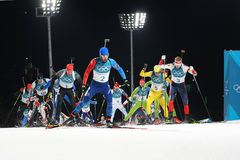 Olympic champion Martin Fourcade of France competes in the biathlon men`s 15km mass start at the 2018 Winter Olympics. PYEONGCHANG, SOUTH KOREA FEBRUARY 18, 2018 Royalty Free Stock Photography