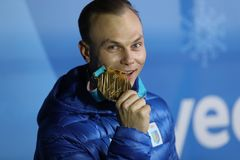 Olympic champion Oleksandr Abramenko of Ukraine celebrates victory in the Men`s Aerials Freestyle Skiing at the 2018 Olympics Royalty Free Stock Photo