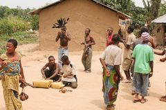 Pygmies dancing and playing on the cans. Stock Image