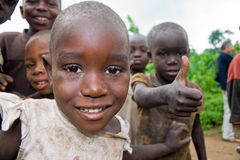 Pygmies. KISORO, UGANDA - DECEMBER 31, 2013: Portrait of an unidentified pygmy child with other unidentified pygmy children in the background. One of the Stock Photography