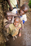 Pygmy children. KISORO, UGANDA - DECEMBER 31, 2013: Portrait of unidentified pygmy children smile into the camera and make fun Stock Image