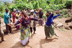 Pygmy people sing and dance in their village. KISORO, UGANDA - DECEMBER 31, 2013: Unidentified pygmy people sing and dance in their village Stock Images