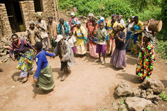 Pygmy people sing and dance in their village. Stock Images