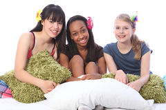 Pyjama party fun for teenage girls in bed at home Royalty Free Stock Images