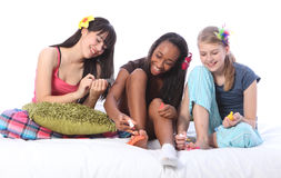 Pyjama Party Pedicure For Ethnic Teenage Girls Royalty Free Stock Photos