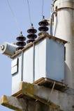 Pylônes électriques de transmission Photographie stock