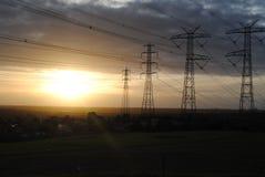 Pylon ηλιοβασίλεμα δύναμης Στοκ Εικόνες