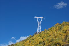 Pylon. A big pylon stands on mountain top Stock Photos