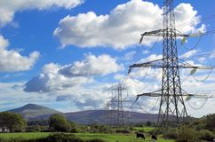 Pylon. Electricity pylon spanning open countryside royalty free stock image
