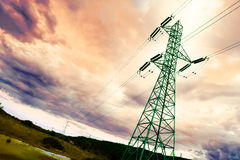 Pylon. High-voltage tower backlit with idyllic sky stock photography
