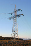 Pylon. In the evening light in front of the Bavarian Alpes Royalty Free Stock Photography