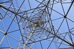 Pylon. Tower structure viewed from directly below against blue sky stock images