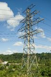 Pylon. Landscape with Electricity pylon, blue sky and clouds Stock Photo