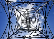 Pylon blue sky. Steel frame of a pylon shot from the bottom up with a nice blue sky above stock photo