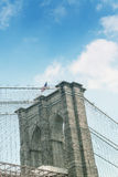 Pylon of Brooklyn Bridge as seen from East River Stock Photography