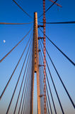 Pylon, cable and the moon. Pylon and cables of new Sava bridge in Belgrade under construction with the moon in background Stock Photos