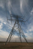 A Pylon carrying High tension electric power lines Stock Image