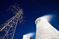 Pylon and cooling towers Royalty Free Stock Photos