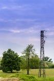 Pylon in the grass. Electric pilon in the grass Stock Image