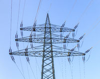 Pylon and high-voltage lines under clear blue sky Royalty Free Stock Photo