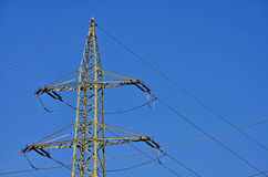 Pylon. Image of an electricity pylon shot against a blue sky stock photo