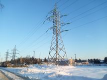 Pylon of the overhead high-voltage power transmission line. Moscow region. Majestic view of the gigantic steel pylon of the overhead high-voltage power Stock Image