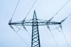 Pylon of a power line. Steel lattice tower of an overhead power line Royalty Free Stock Photo