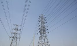 Pylon and power lines at local road Royalty Free Stock Photography