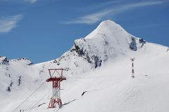 Pylon and ropes of the mountain railway that leads to the summit of the 3029m high Kitzsteinhorn. Mast and ropes of the mountain railway that leads to the summit royalty free stock photography