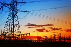 Pylon. The silhouette of the evening electricity transmission pylon royalty free stock photos