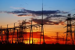 Pylon. The silhouette of the evening electricity transmission pylon royalty free stock photography