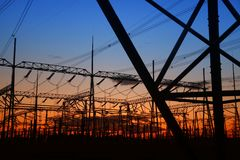 Pylon. The silhouette of the evening electricity transmission pylon stock photo