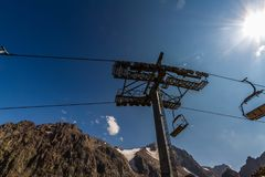 Pylon of Ski lift in Summer. Near Shymbulak Ski Resort Hotel in Stock Photo