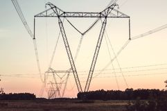 Pylon and transmission power line. In sunset Stock Photography